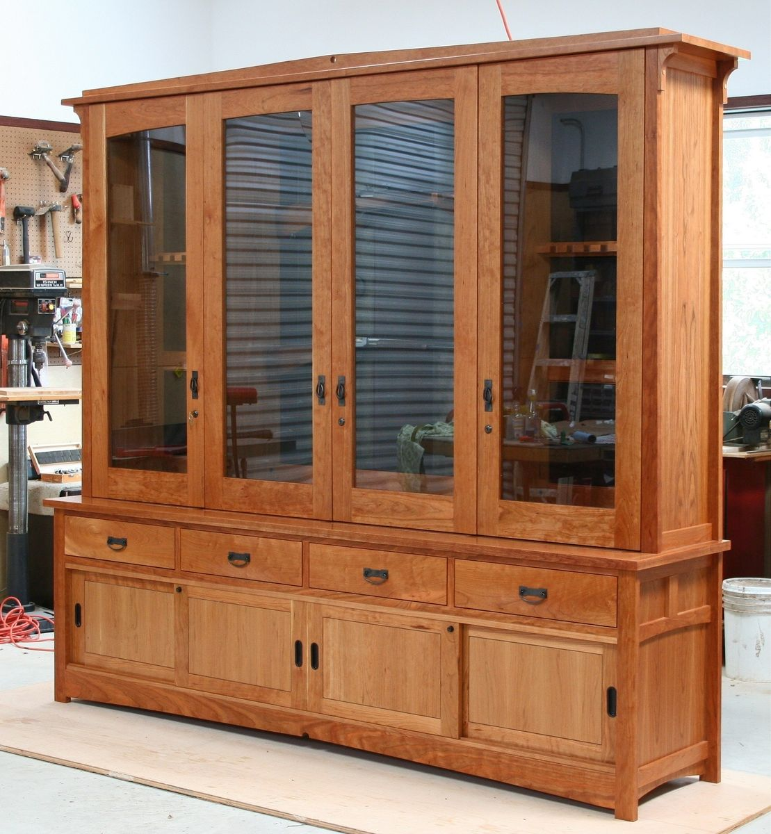 Hand made tally gun cabinet by white wind woodworking for Custom wood cabinets