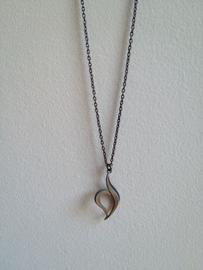 Custom Made Necklace With The Eating Disorder Recovery Symbol.
