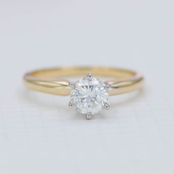Sometimes, you just can't beat a classic. A yellow gold, 6 prong setting holds an heirloom round diamond in this simple, but beautiful ring.