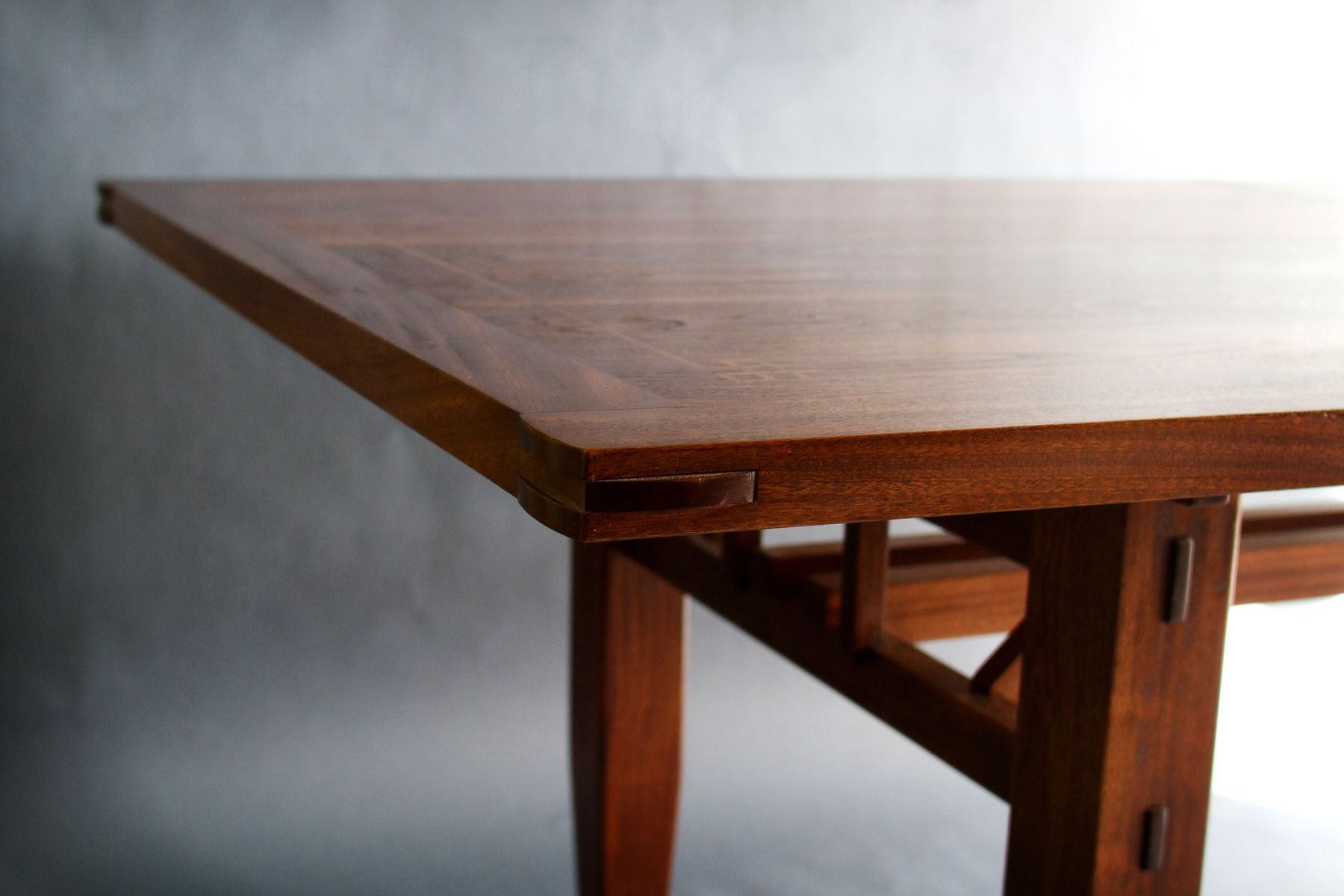 custom made walnut and sapele dining table by bow river craftsman llc