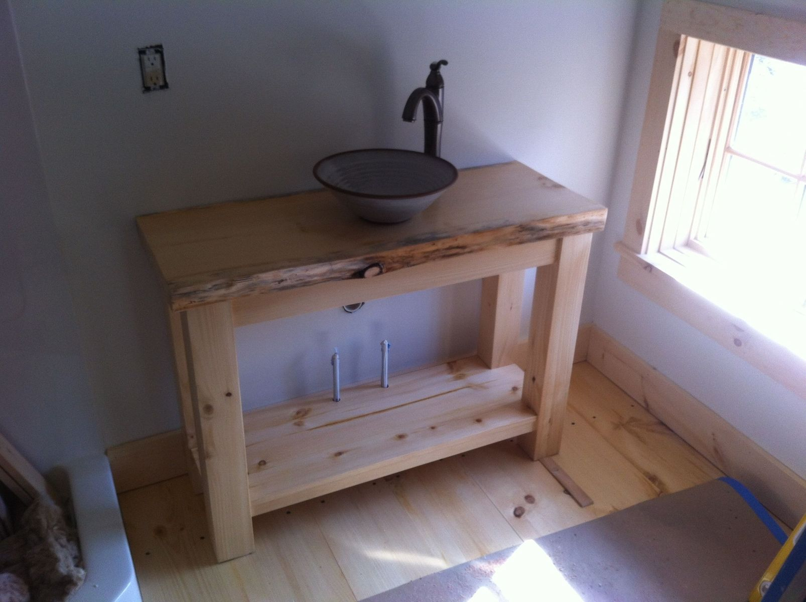 Custom made rustic pine vanity with vessel sink