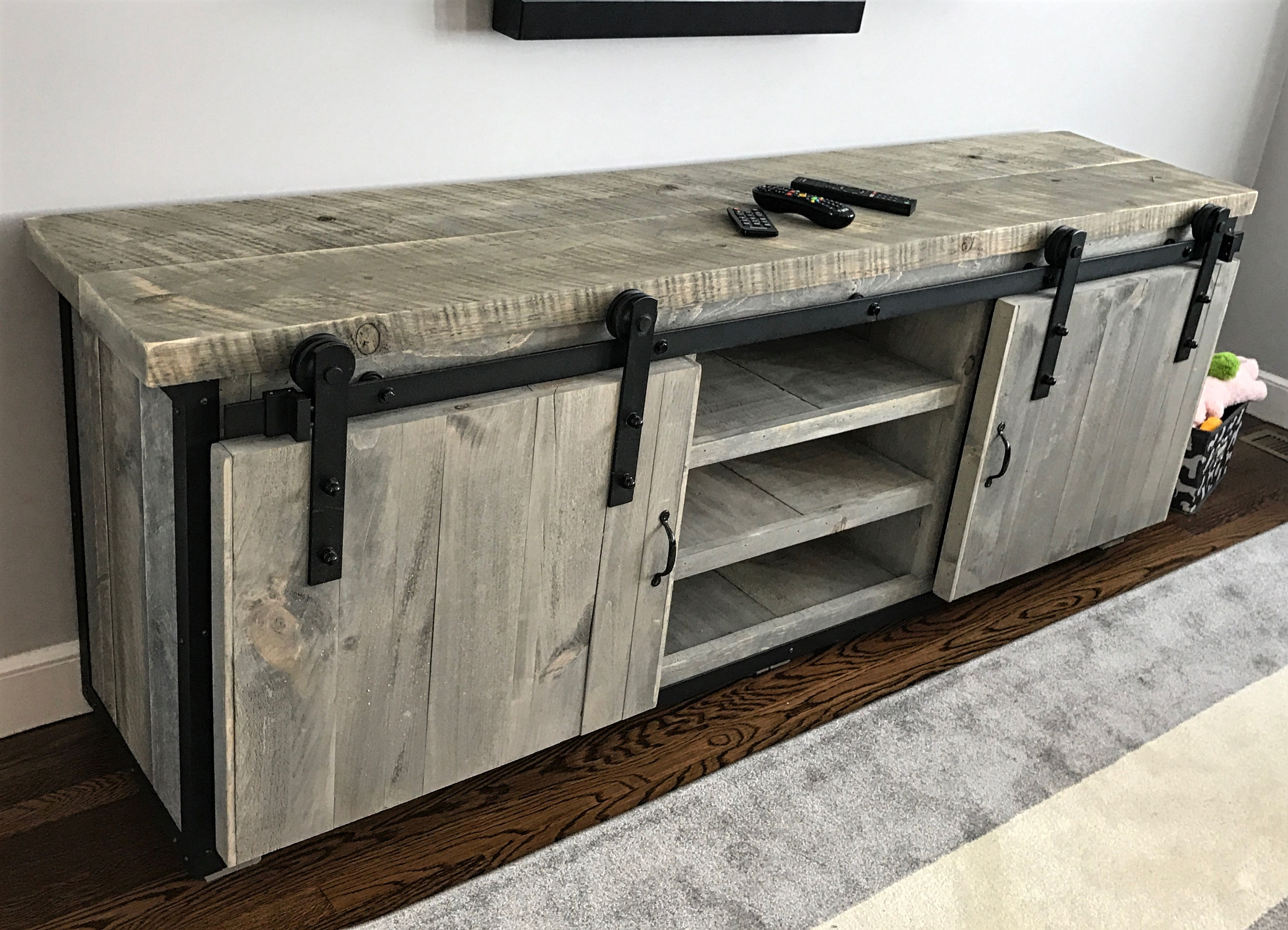 hand crafted rustic industrial barn board media stand w sliding doors by the crabby lion. Black Bedroom Furniture Sets. Home Design Ideas