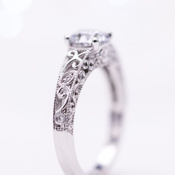 Delicate white gold filigree with a low-profile setting for a lab-created round diamond.