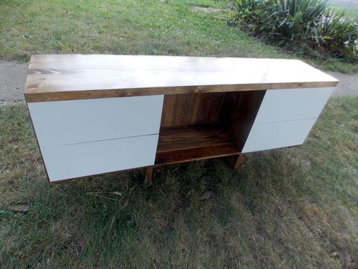 Custom Made Entertainment Center Featuring Clam Shell Doors