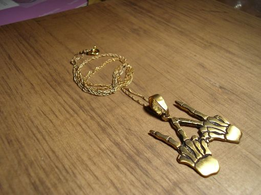 Custom Made Skeleton Hands Gold Pendant