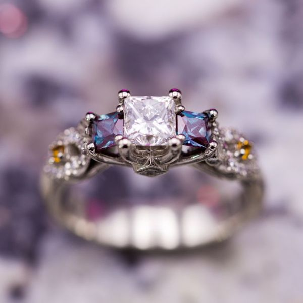 Princess cut diamond engagement ring with alexandrite side stones, citrine accents, and peekaboo side stones.