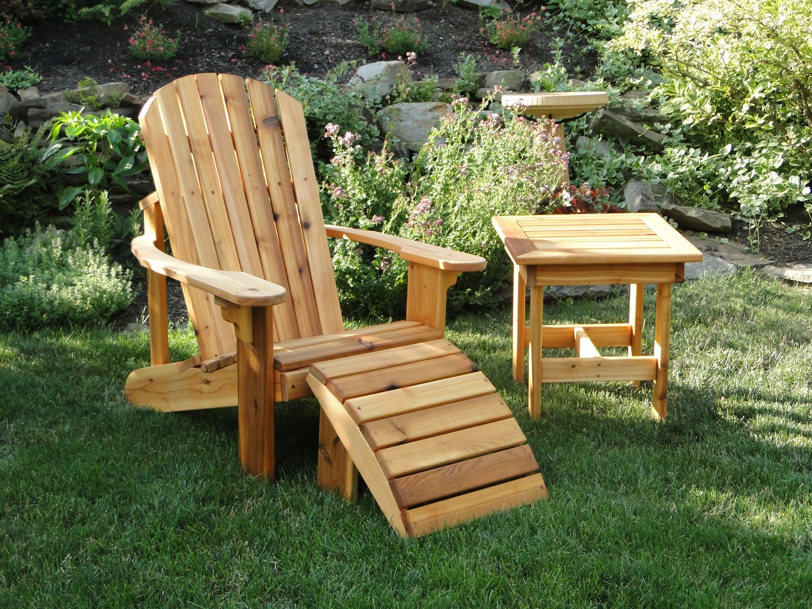hand crafted adirondack chair with leg rest and side table by teaky