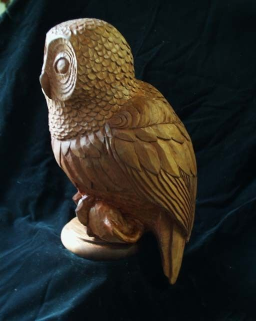 Custom made carved owl by stick and stone studio