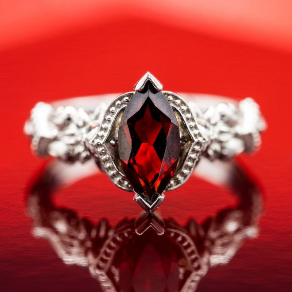 The bright red of this marquise garnet pops against a gothic, vintage-inspired setting in white gold.
