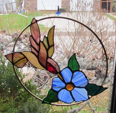 Custom Made Hummingbird Stainedglass With A Blue Flower