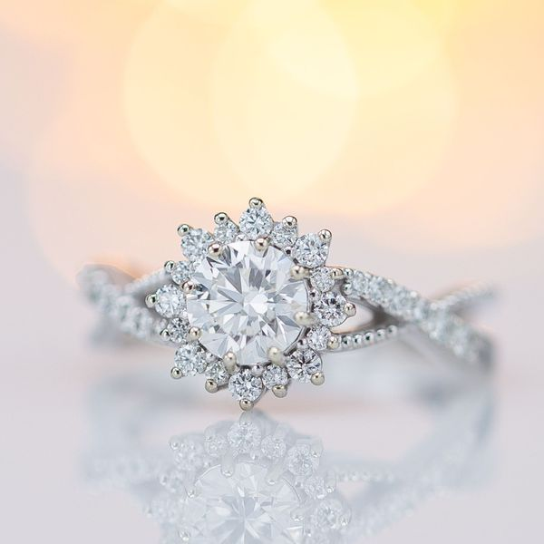 The bright sunburst halo of this diamond engagement ring sparkles like crazy.