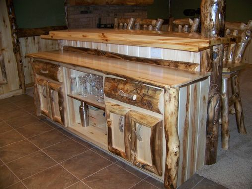 Hand Crafted Custom Refinished Basement With Log Bar Bar
