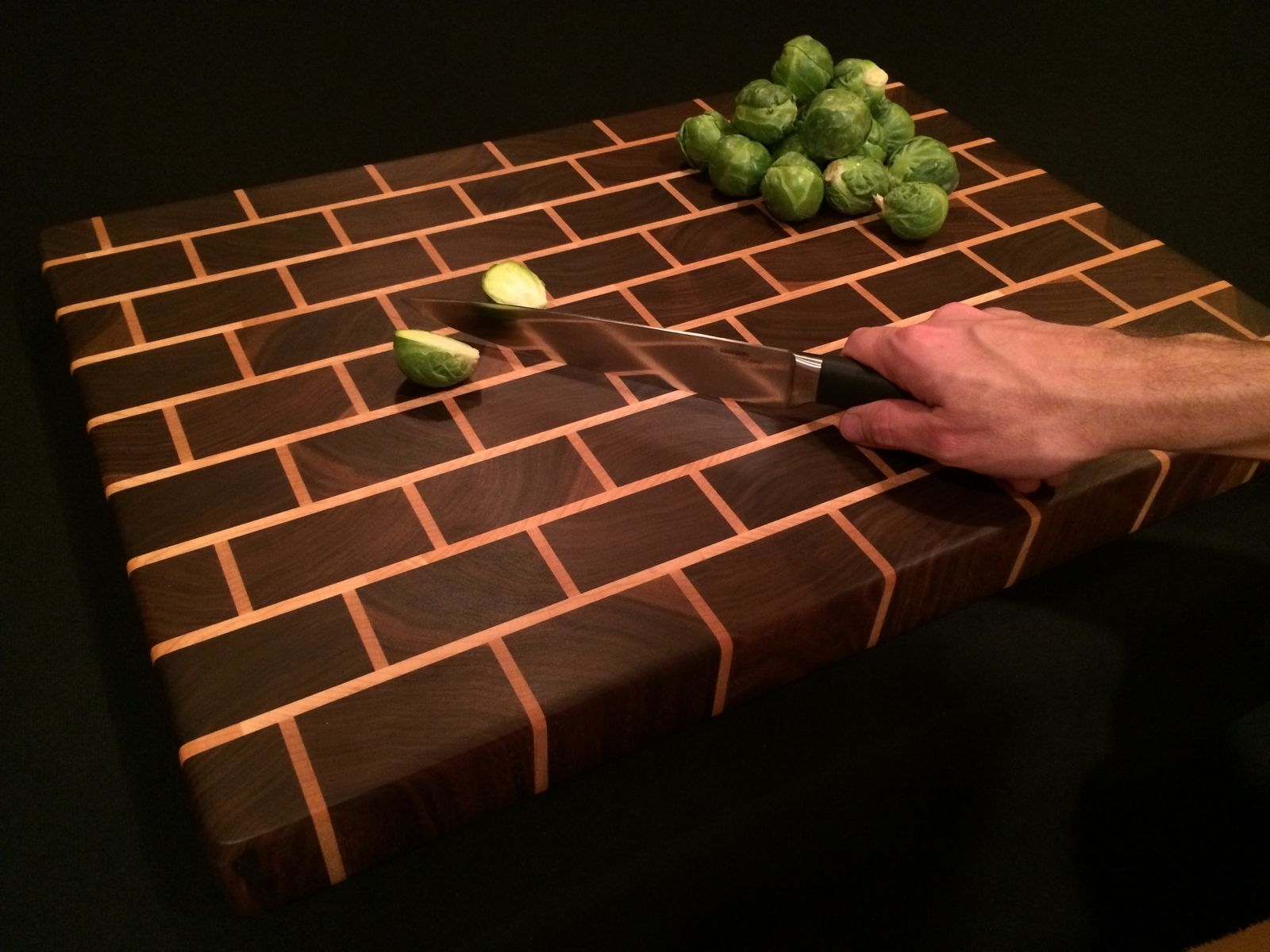 hand made signature black brick design end grain cutting board by