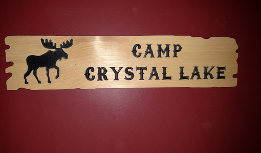 Custom Made Custom Cedar Signs With Silhouette Graphics And Unique Edge
