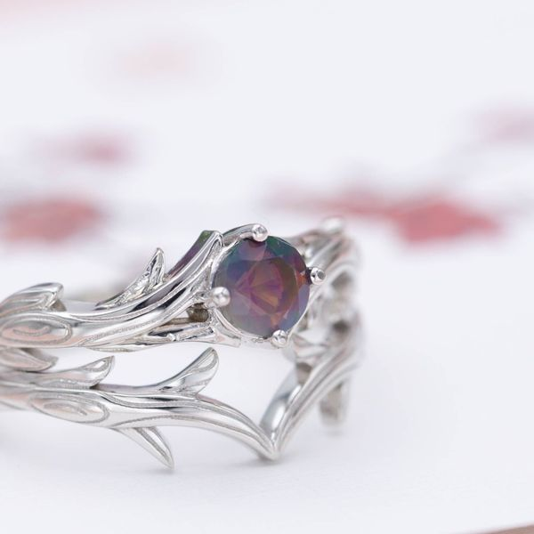 A faceted, dusky purple opal lends its unique color to this nature-inspired bridal set.